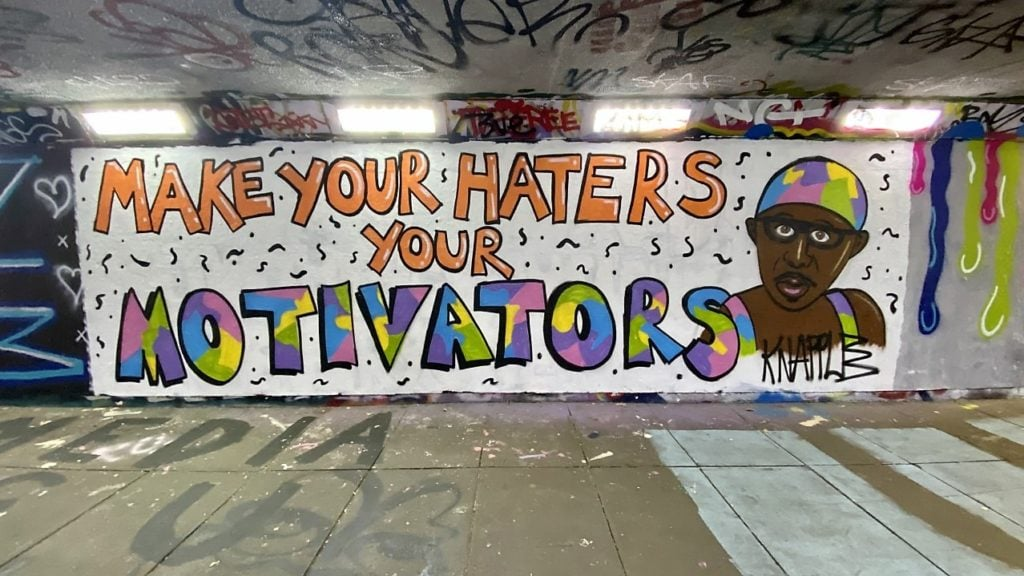 "example of street art in Norwich, this mural was found in the Pottergate underpass and says ""make your haters your motivators"""