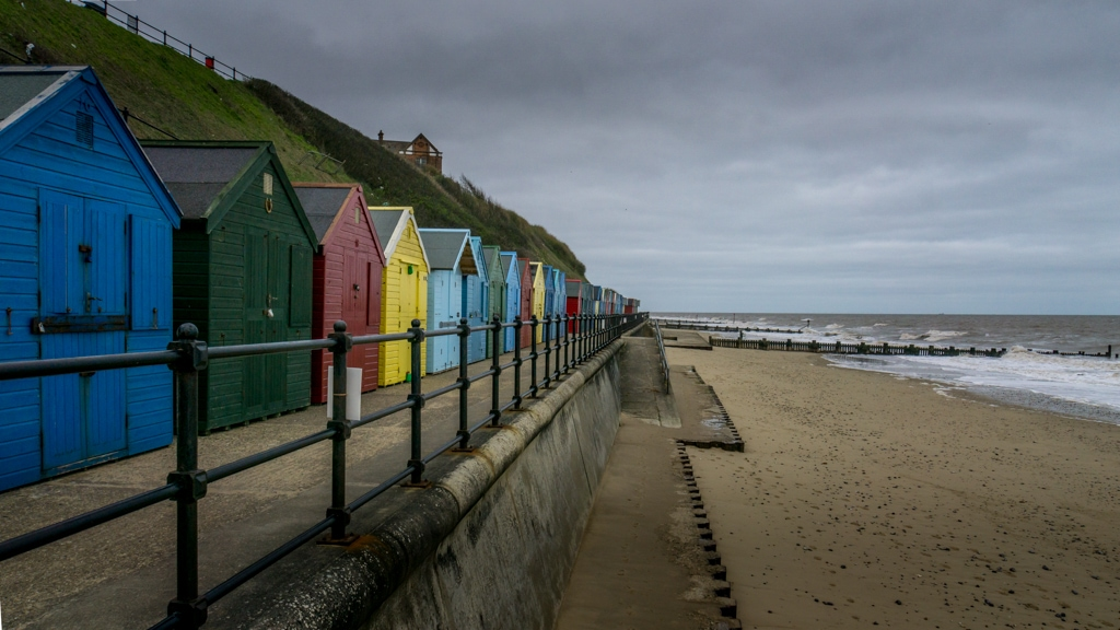 colourful beach huts by Mundesley Beach in Norfolk.