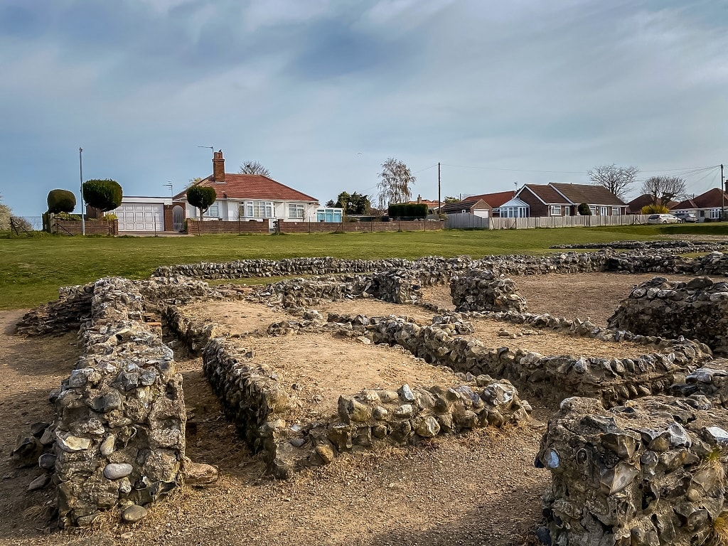 caister roman ruins with houses in the background