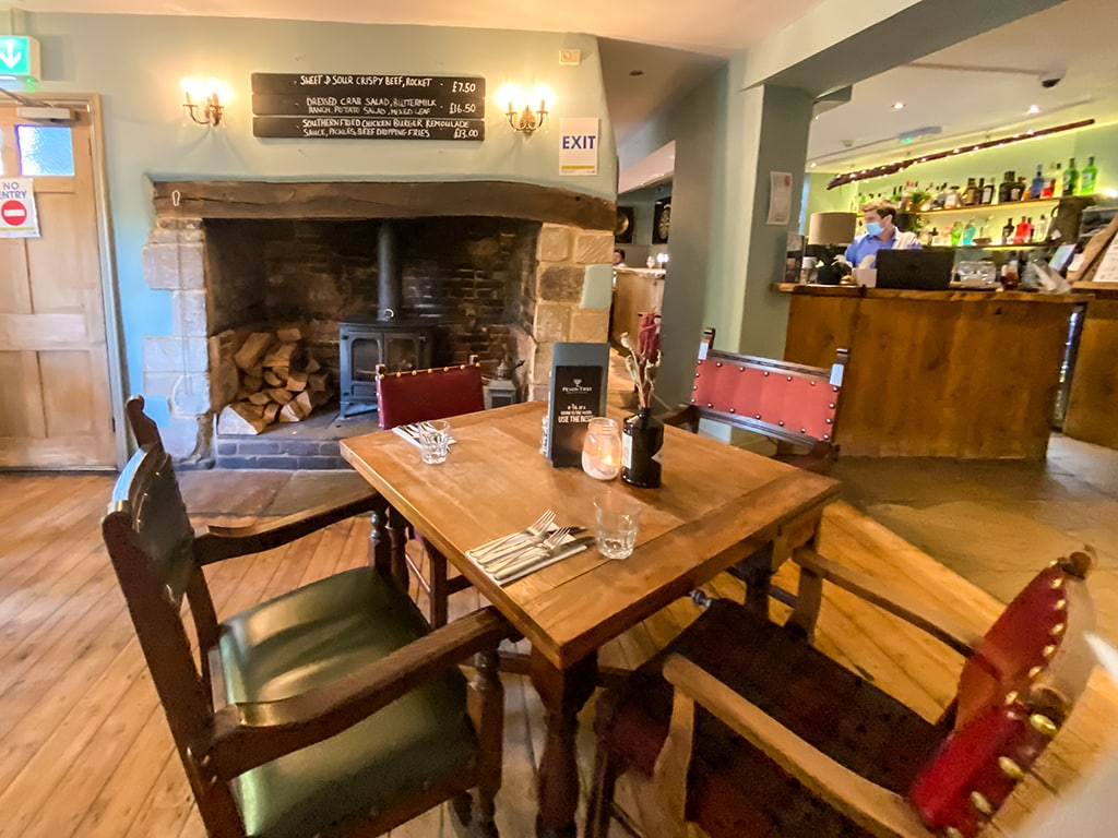 table and fireplace inside the dabbling duck pub