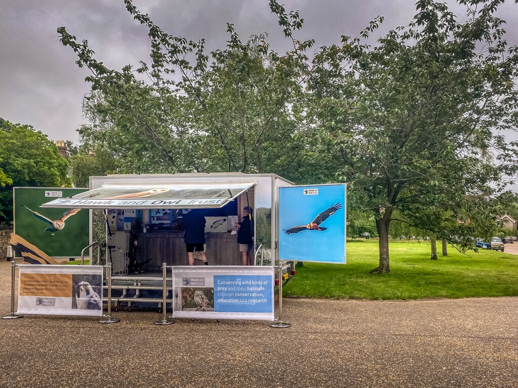 hawk and owl trust booth outside Norwich Cathedral