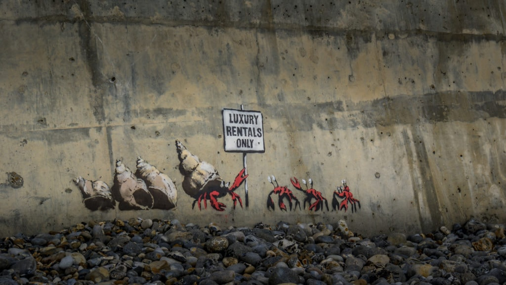 Banksy artwork in Cromer Norfolk, hermit crabs with a sign that says luxury rentals only